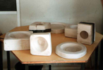 a variety of plaster moulds for making ceramic objects in different shape and sizes
