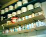 photo showing glaze materials stored in jars on shelves